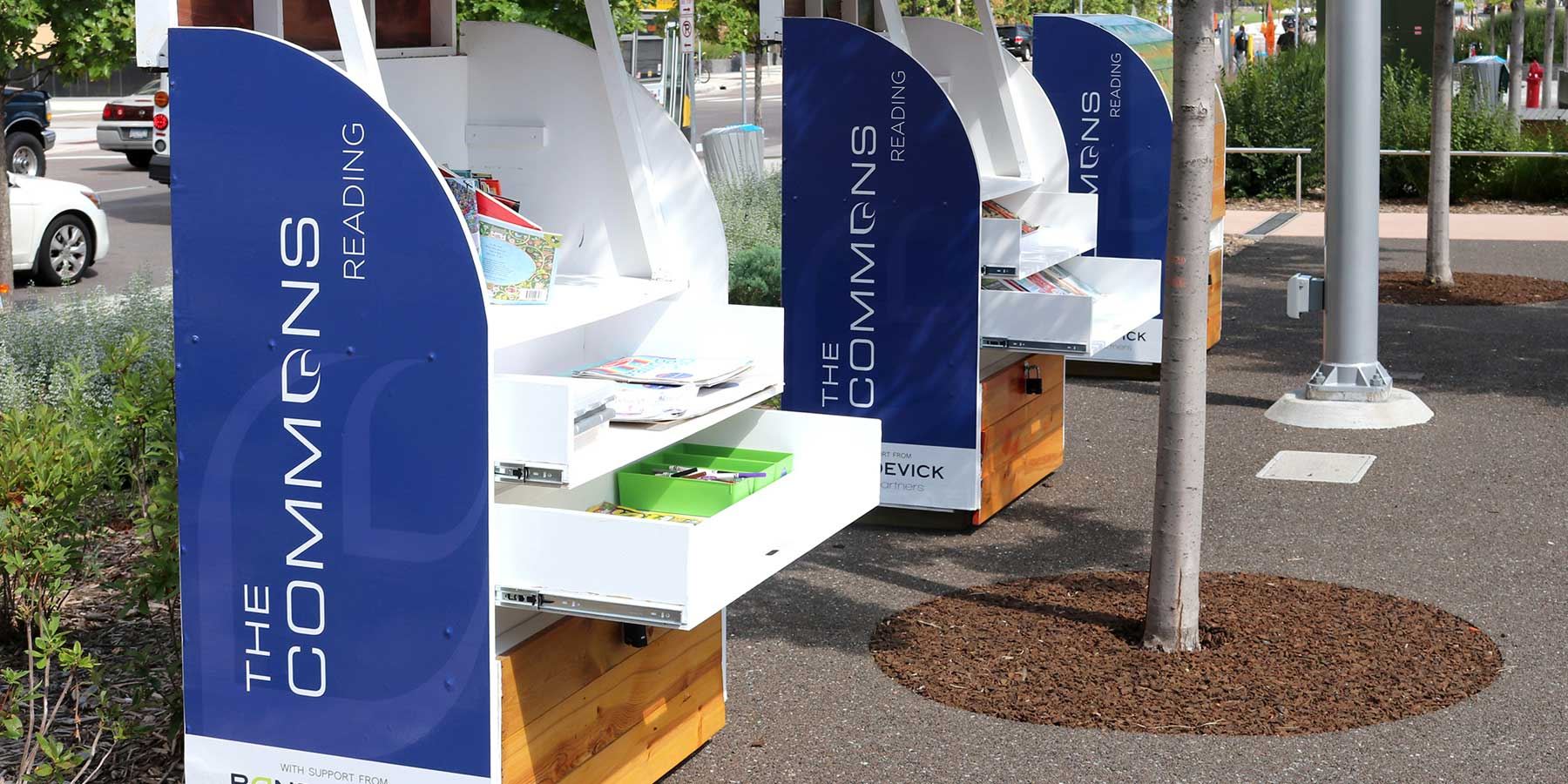 A park kiosk with the Commons logo in Minneapolis